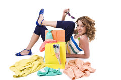 Young colorful dressed woman with color shopping bags on white Stock Image