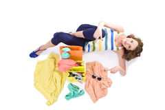Young colorful dressed woman with color shopping bags on white Stock Images
