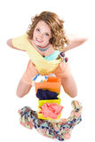 Young colorful dressed woman with color shopping bags on white Stock Photo