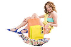 Young colorful dressed woman with color shopping bags on white Royalty Free Stock Photo