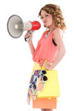 Young colorful dressed woman shopping and shouting trough loudspeaker. Young woman shopping and shouting trough loudspeaker Stock Images