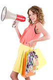 Young colorful dressed woman shopping and shouting trough loudspeaker Royalty Free Stock Photo