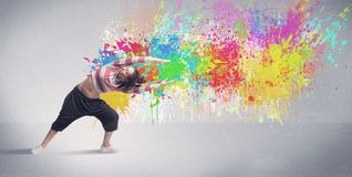 Young colorful street dancer with paint splash Stock Images