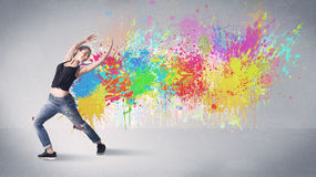 Young colorful street dancer with paint splash Royalty Free Stock Images