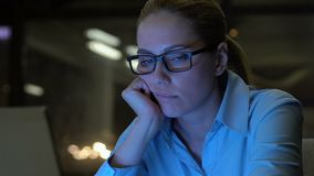 Young company employee feeling bored during night shift office, lack of interest. Stock footage stock video