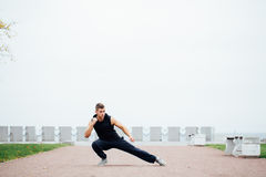 Young competitor does some warm up stretches before the big race. Stock Photography