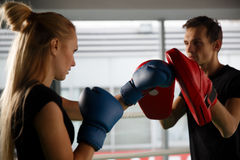 Young competitors trains in boxing Royalty Free Stock Image