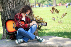 Young composer in park Royalty Free Stock Images