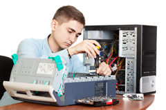 Young computer engineer. Technician repairing computer hardware in the lab.  Studio shot Royalty Free Stock Image