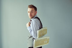 Young computer geek carrying keyboards underhand Stock Photo
