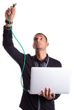 Young computer scientist plugin a ethernet wire. Young african american computer scientist plugin a ethernet cable, isolated on white background Royalty Free Stock Photos