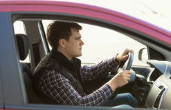 Young concentrated man driving a car Royalty Free Stock Photo