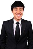 Young and confident Asian business man. Stock Photos