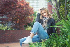 Young confident attractive woman sitting ouside Stock Images