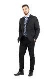 Young confident bearded business man in suit looking at camera. Full body length portrait isolated over white studio background Stock Photo