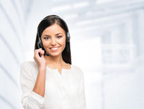 Young, confident and beautiful customer support operator stock images