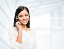 Young, confident and beautiful customer support operator Royalty Free Stock Image
