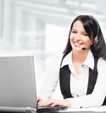 Young, confident and beautiful customer support operator. Working in a call center royalty free stock photos