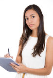 Young, confident beautiful woman/student or businessperson writing serious notes Stock Images