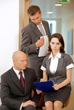 Young confident boss and his secretary Stock Images