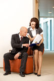 Young confident boss and his secretary looking on documents Royalty Free Stock Image