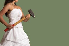 Young confident bride with a sledgehammer Royalty Free Stock Image