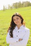 Young confident brunette arms folded Royalty Free Stock Photos