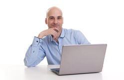 Young confident business man with laptop Royalty Free Stock Image