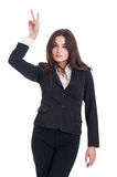 Young and confident business woman showing peace or victory gest Royalty Free Stock Images