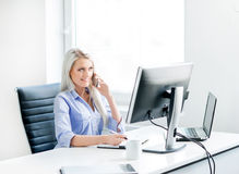 Young and confident business woman working in office Stock Images