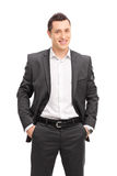 Young confident businessman in a black suit Stock Photography