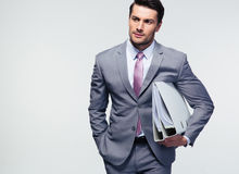 Young confident businessman holding folders Stock Images