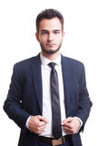Young confident businessman looking in camera on white backgroun Stock Image