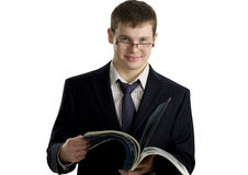 Young confident businessman reading stock image