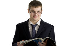 Young confident businessman reading Stock Photography