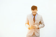 Young confident businessman is searching information on touch pad during work break royalty free stock photo