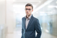 Young confident businessman standing in the office Royalty Free Stock Images