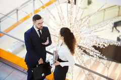 Colleagues talking in the mall royalty free stock photography