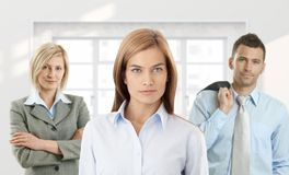 Young confident businesspeople. Portrait of young confident businesspeople looking at camera royalty free stock image