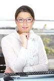 Young confident businesswoman in the office royalty free stock photos