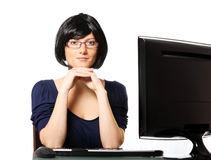 Young confident businesswoman in the office stock photo