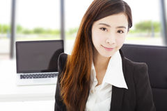 Young confident businesswoman sitting in her office Stock Images