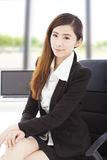 Young confident businesswoman sitting in her office Royalty Free Stock Photography