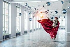 Super woman in sky Stock Photos