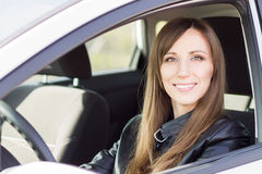 Young confident car driver woman steering wheel. Royalty Free Stock Images