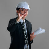 Young confident engineer. On grey with clipping path royalty free stock photography