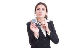 Young confident female doctor or medic holding stethoscope to ca Royalty Free Stock Image