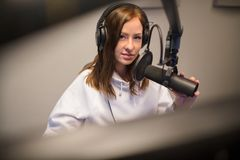 Jockey Using Headphones And Microphone In Studio Royalty Free Stock Photography