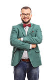 Young confident hipster with a green coat Royalty Free Stock Images