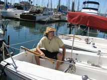 Young confident man at boat ma. Young confident man smiling boat marina hat and sunglasses on Stock Photos